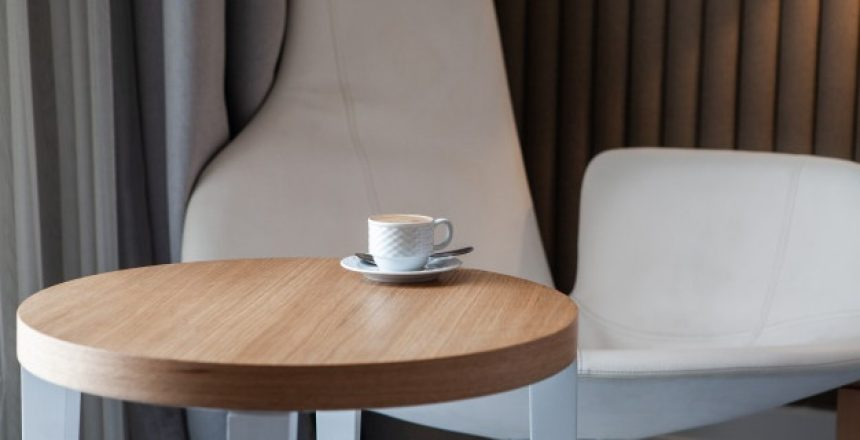 side-view-cup-coffee-small-round-table-horizontal_176474-2487